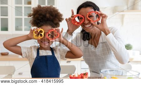 Happy Excited Mommy And Daughter Girl Having Fun While Cooking