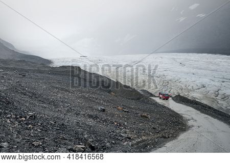Columbia Icefield, Canada - 08.29.2018: Red And White Brewster Canada Off-road Sightseeing Bus Going