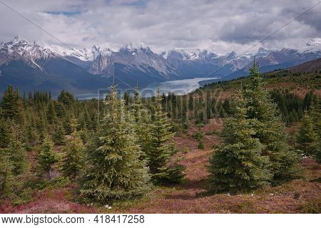 Clouds Gathering Above The Mountain Range In Canadian Rockies. Beautiful Maligne Lake In Jasper Nati