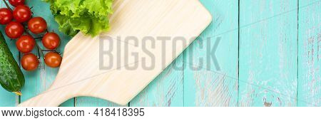 Cutting Board On A Vintage Wooden Table. Handmade Chopping Board. Fresh Tomatoes, Cucumbers And A Cu