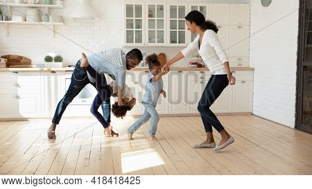 Excited African American Family Celebrating Moving Into New House