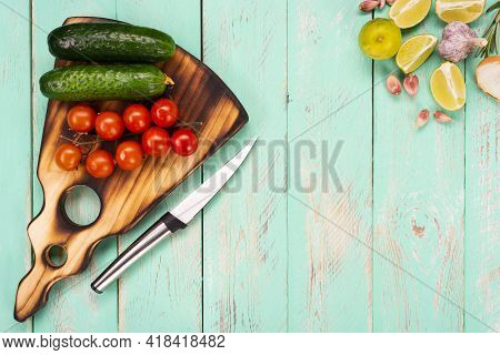 Cutting Board On A Vintage Wooden Table. Handmade Chopping Board. Fresh Tomatoes, Cucumbers, Lime Sl