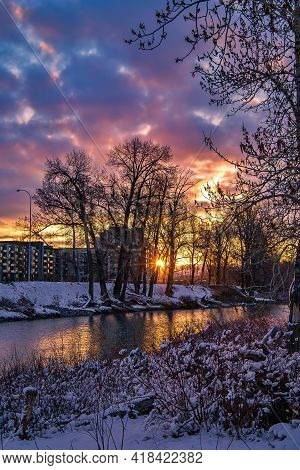Vibrant Sunrise Cloudscape Over A Spring Park