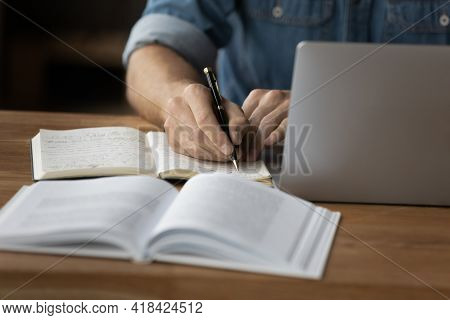 Close Up Of Man Make Notes Work Online On Computer