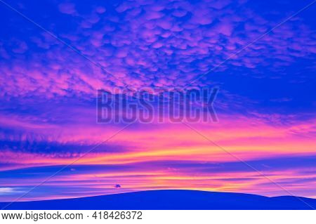 Winter Landscape With Mountain During Amazing Vivid Saturated Beautiful Sunset Sky In Pink, Purple A