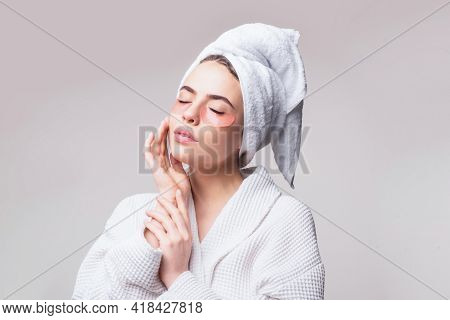 Woman Applying Eye Patches. Calm Relaxed Woman Has Fresh Healthy Skin, Keeps Eyes Shut, Wears Collag
