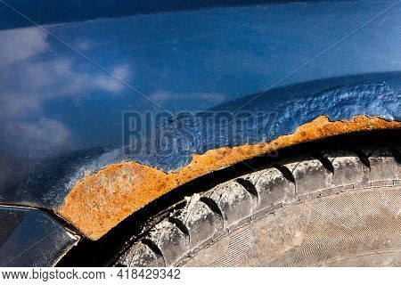 Traces Of Rust And Tear Close-up On The Old Dirty Metal Surface Of The Car. Amortization Of The Mach