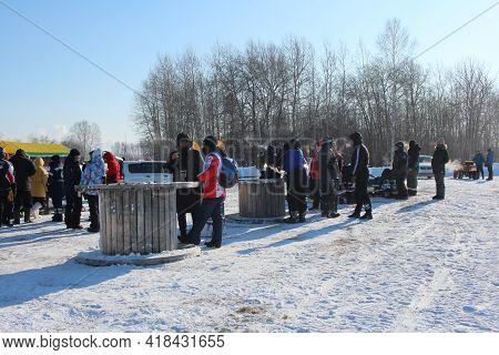 Russia, Novosibirsk 22.02.2021: In Winter, Men On The Street In Siberia Met For Recreation Communica