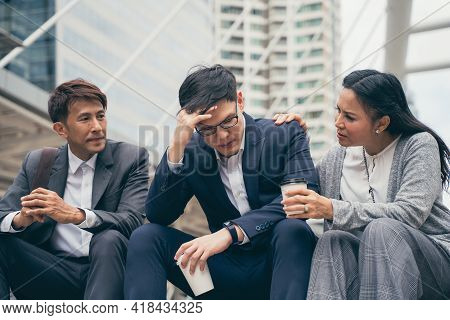 Frustrated Upset Asian Business Team With Bad Work Result And Disappointed In Business Project, Sett