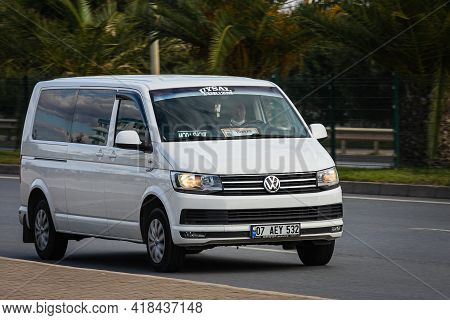 Alanya, Turkey  - April 13  2021:   White  Volkswagen Caravelle   Is Driving Fast On The Street On A