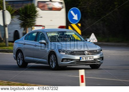 Alanya, Turkey  - April 13  2021:    Silver Volkswagen Passat    Is Driving Fast On The Street On A