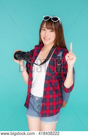 Beautiful Young Asian Woman Presenting Travel Trip Summer With Pointing Something Isolated On Blue B