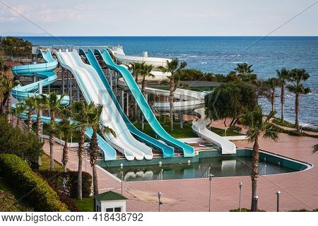 A Disabled  Aquapark  With High Slides By The Sea With A Large Untreated Pool Without People In A Ho