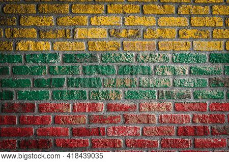 National Flag Of Lithuania Depicting In Paint Colors On An Old Brick Wall. Flag  Banner On Brick Wal