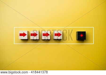 Wooden Cube Block With Arrow Navigate To Symbols Target On Wooden Cube Block On Beautiful Yellow Bac