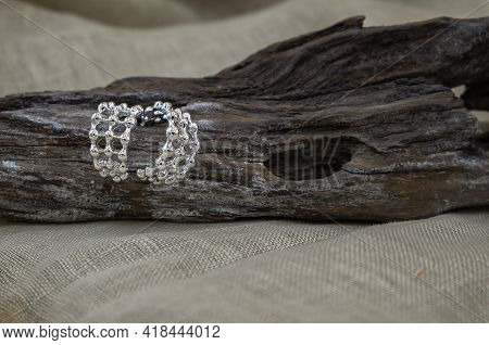 Silver Jewellery Setup. Silver Jewelry Fashion Photography. Silver Earrings Fashion Photography. Ear