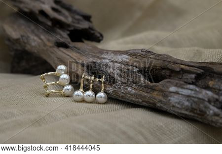 Golden Jewellery Setup. Golden Jewelry Fashion Photography. Golden Earrings White Pearl Fashion Phot