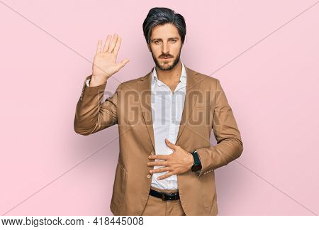 Young hispanic man wearing business clothes swearing with hand on chest and open palm, making a loyalty promise oath