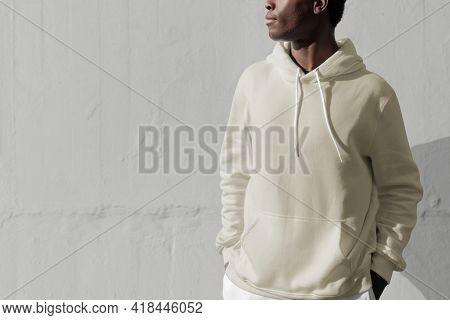 Man in white hoodie streetwear men's apparel fashion