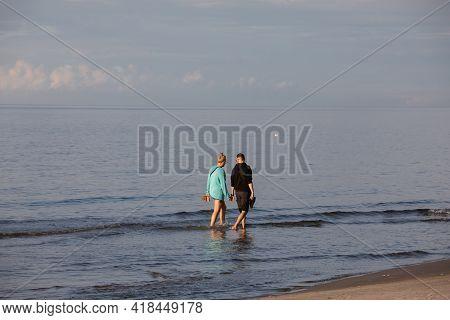Stegna, Poland - September 4, 2020: Romantic Walk Of A Couple In Love On The Beach In Stegna, Pomera