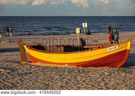 Jantar, Poland - September 7, 2020: Colorful Fishing Boat On The Beach By The Seaside In Jantar, Pom