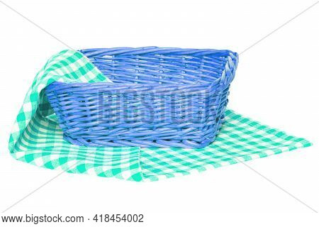 Empty Picnic Basket. Closeup Of A Empty Wicker Basket On A Green White Checkered Napkin, Blanket Or
