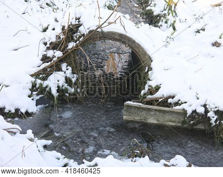 Concrete Pipe In A Street Ditch In Winter