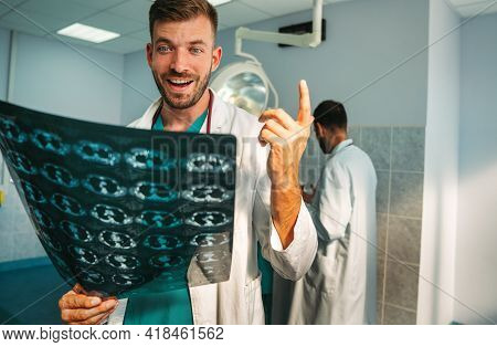 Doctor Radiologist Looking At X-ray Images In Hospital. Healthcare, Radiology, People Concept