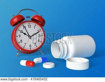 Alarm Clock, Tablets And White Pills Bottle On Blue Background With Copy Space. Medicine Concepts. M