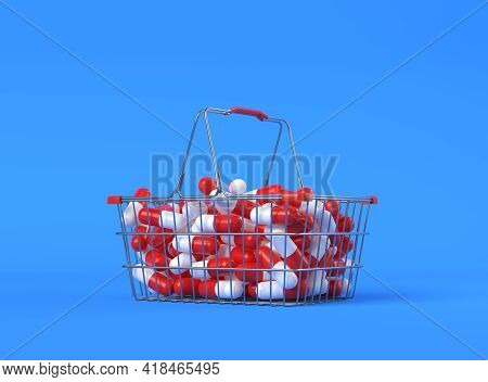 Heap Of Red-white Pills In A Metal Shopping Basket On Blue Background With Copy Space. Medicine Conc