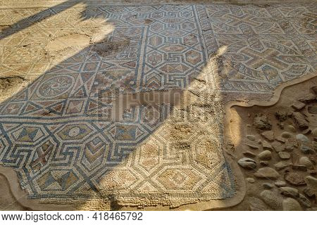 Remains Of Floor Mosaics In Antique Church. Ornaments Are Depicting Intricate Pattern With Geometric
