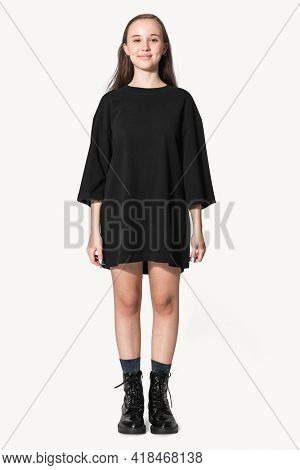 Teenage girl in black oversized tee grunge fashion shoot with design space