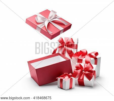 Red Opened Gift Box With Group Of White Gift Boxes Isolated On White Background - Clipping Path Incl