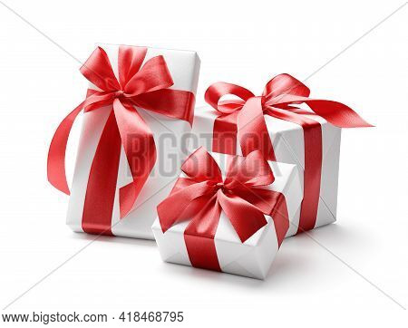White Gift Boxes With Red Bows Isolated On White Background - Clipping Path Included