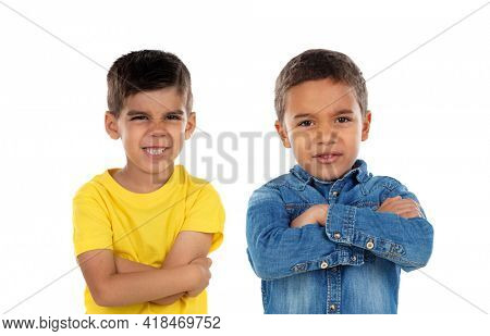 Two funny children pretending to be angry isolated on a white background