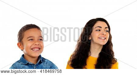 Funny child with his higher sister isolated on a white background