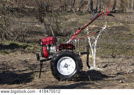 Machinery Cultivator For Soil Cultivation In The Garden, Motor Cultivator.