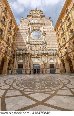 Montserrat, Barcelona - Spain. July 15, 2020: Facade And Mosaic Floorof At The Entrance To Basilica