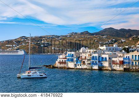 Famous Romantic Neighbourhood Little Venice, Mykonos, Greece. Whitewashed Old Fisherman Houses At Da