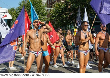 Barcelona - Spain. June 29, 2019: A group of athletic sexy young men promotes gay sexual underwear brand