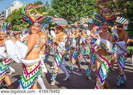 Barcelona - Spain. June 29, 2019: Carnaval latinamerican costumes consisting of long skirts and trawsers with accent on wide brim sophisticated hats, all in gay freedom colors