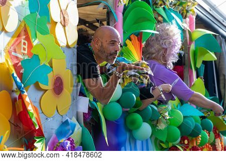 Barcelona - Spain. June 29, 2019: A man at a gay pride parade from a flower-decorated van blows a kiss to the parade spectators