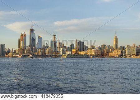 Midtown Manhattan Skyline On The Hudson River At Dusk In New York, New York, Usa.