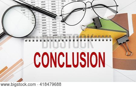 Text Conclusion On White Paper Notebook On The Diagram. Business