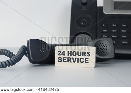 Closeup Of The Wooden Block With Text - 24 Hours Service - Always Available Support. Office And Comm