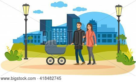 Young Parents Strolling In Park With Gray Baby Stroller. Dad Rolls Stroller With Newborn, Wife Holds