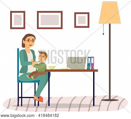 Mother Feeding Baby Child Sitting On Her Knees. Holding Hands With Spoon Going To Mouth. Mom Gives H