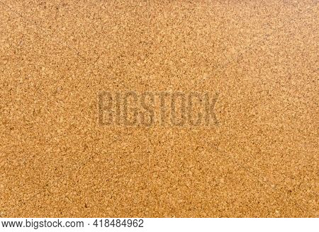 Brown and yellow color of cork board. Textured wooden background. Cork board with copy space. Notice board or bulletin board image.