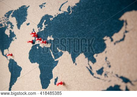 Atlas Of Earth And Continents With Red Pins For Traveling. With Pinned Positions For Journey, Trip O