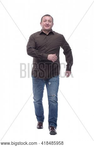 in full growth. satisfied casual man striding forward .